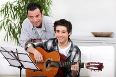a guitar instructor and a student